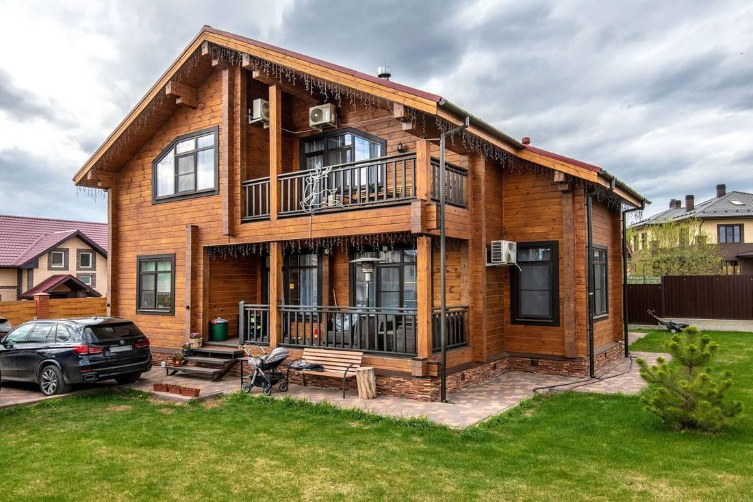 Красивые деревянные дома из бруса и фото стилей
