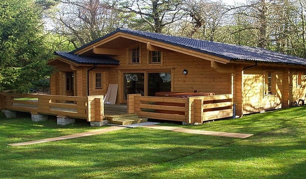 Деревянные дачные дома в деревне: стили и отделка