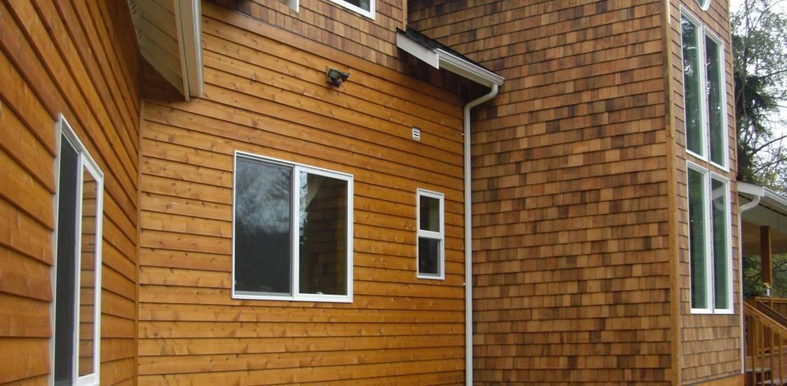 Обшивка дома из бруса снаружи: выбираем материал
