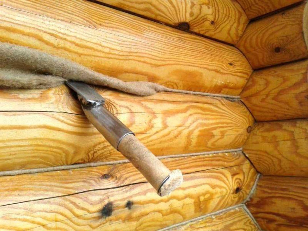 Конопатка дома из бруса своими руками - видео инструкция, обзор инструментов и материалов
