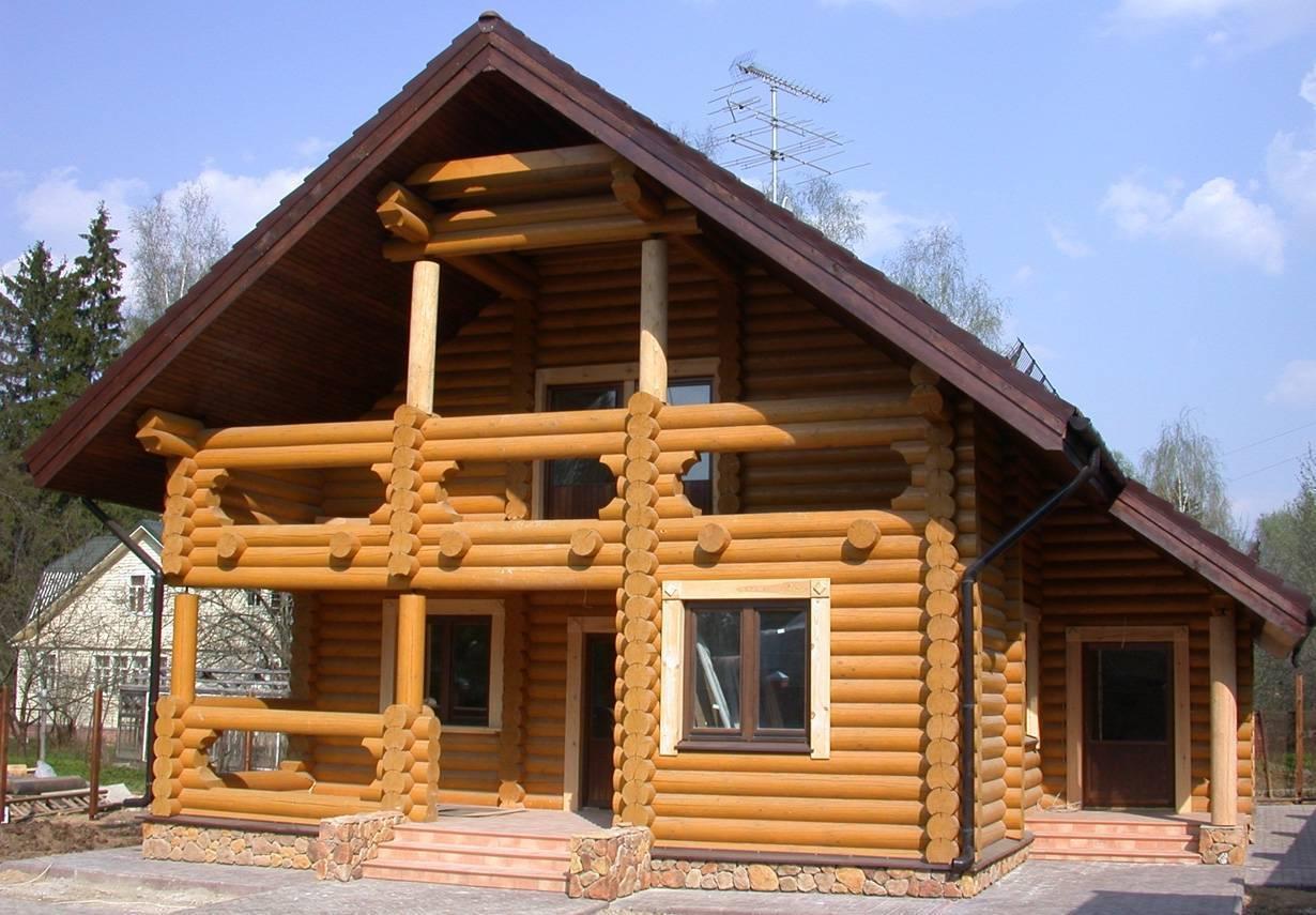Дома из оцилиндрованного бревна: плюсы и минусы, особенности