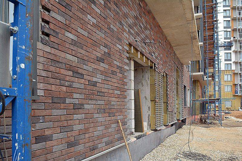 Фасад дома клинкерной плитки, виды материала и техника нанесения