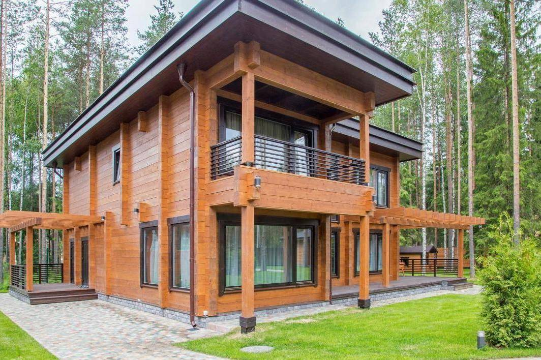 Дома из клееного бруса деревянные и этапы строительства
