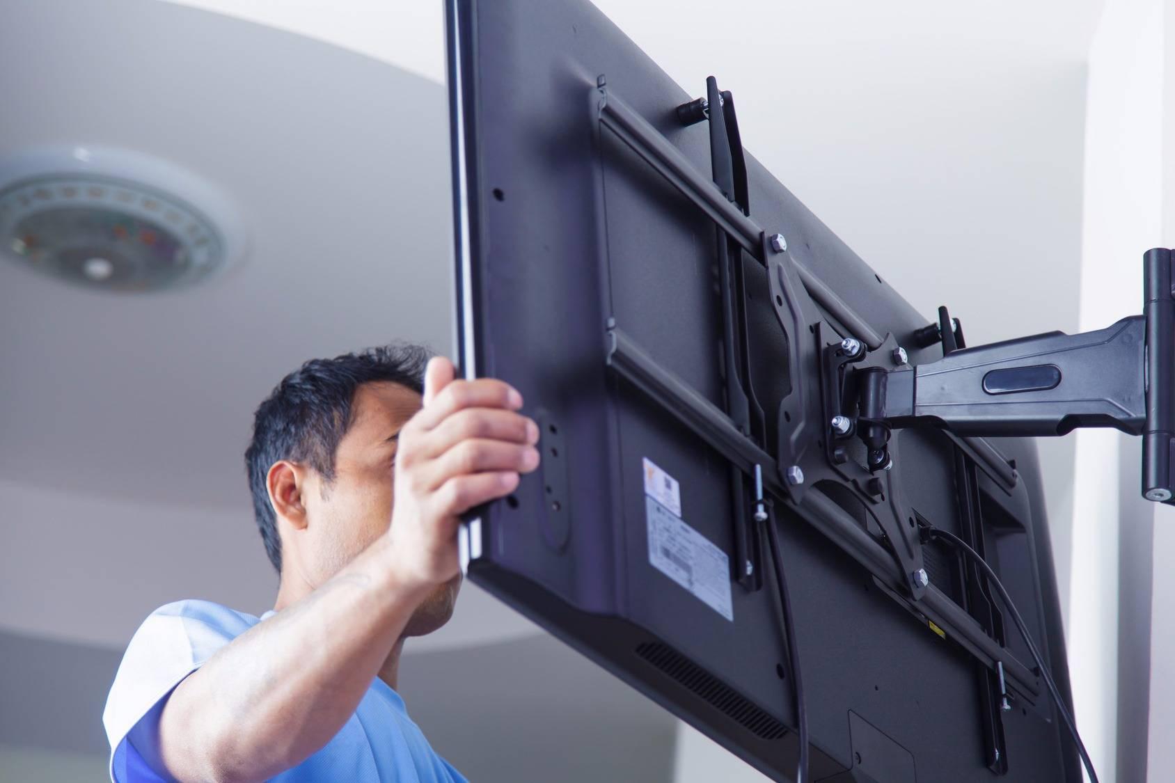 Крепление для телевизора на стену: выбор и установка крепежа
