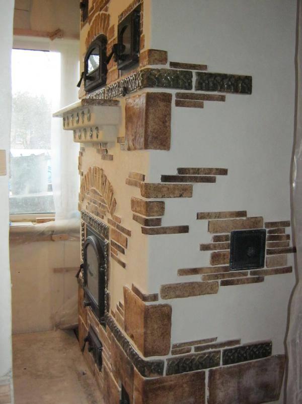 Как отделать камин — штукатурка, облицовка плиткой, камнем