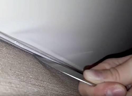 Как снять натяжной потолок?