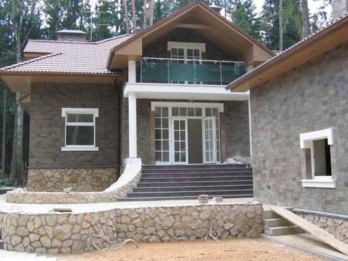 Камень на фасаде дома: 33+ фото облицовки