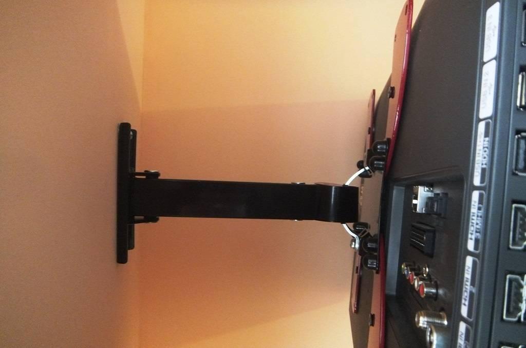 Как повесить телевизор на стену своими руками: кронштейны, крепления