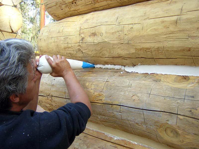 Как конопатить дом из бревна: этапы работ